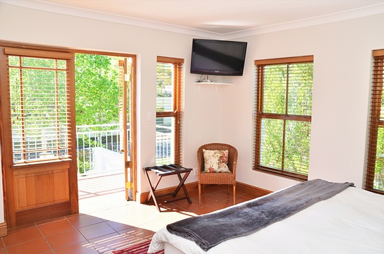 Spacious bedroom with satellite television and private balcony