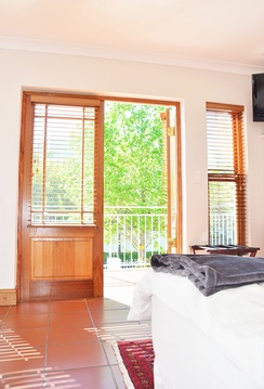 Double room with king sized bed and private balcony